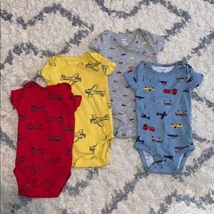 4 short sleeve onesies 6month size. Cars, trucks